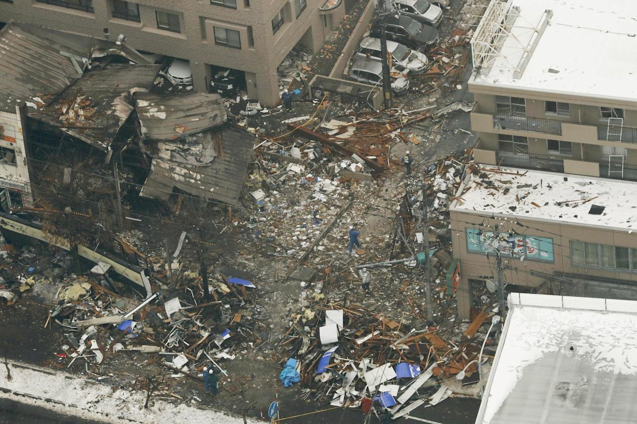 <p>An aerial view shows workers inspecting the site where a large explosion occurred at a restaurant in Sapporo, Hokkaido, northern Japan, on Dec.17, 2018. (Photo: Kyodo/via Reuters) </p>