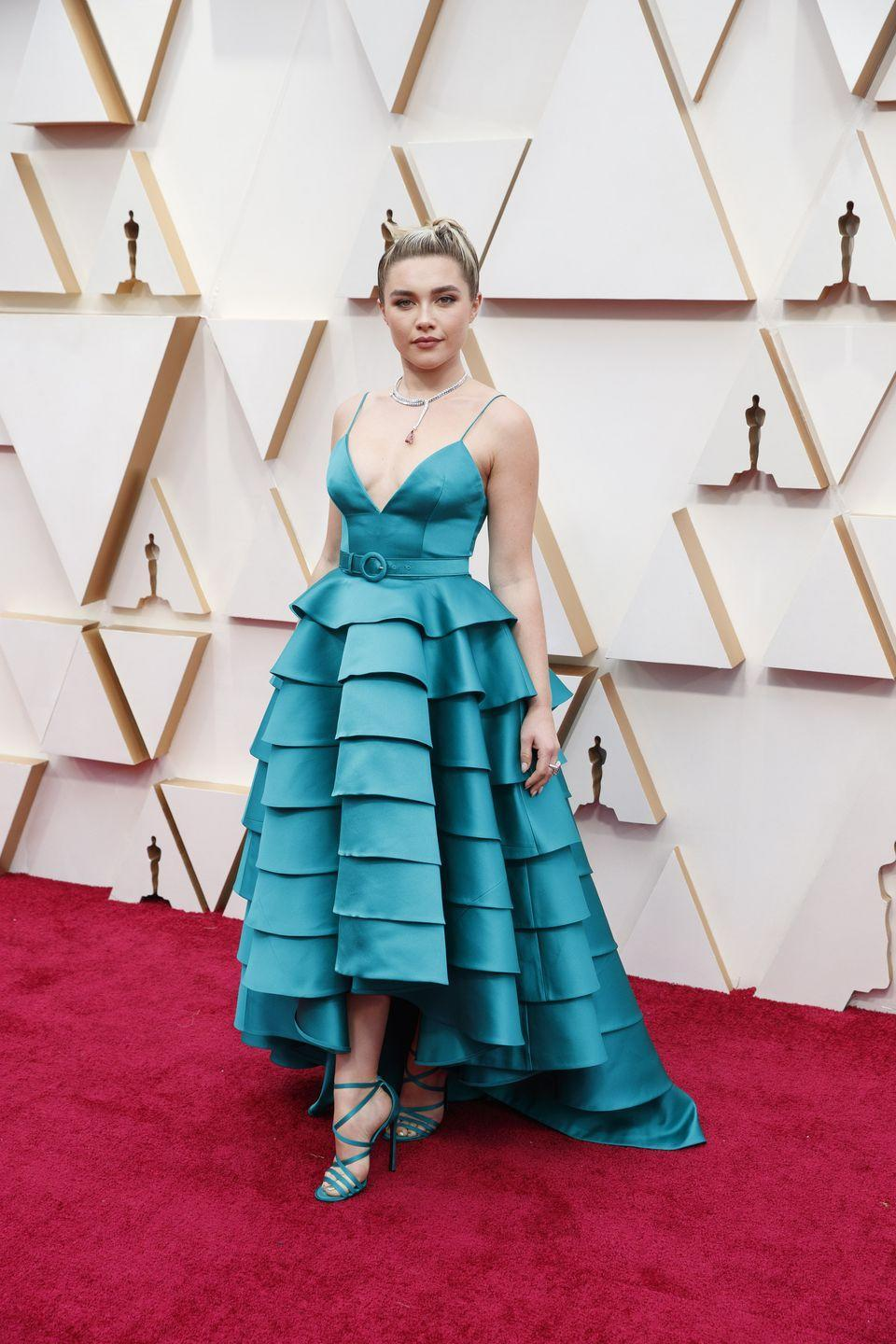 <p>Florence Pugh in a belted teal Louis Vuitton gown and matching strappy heels. </p>