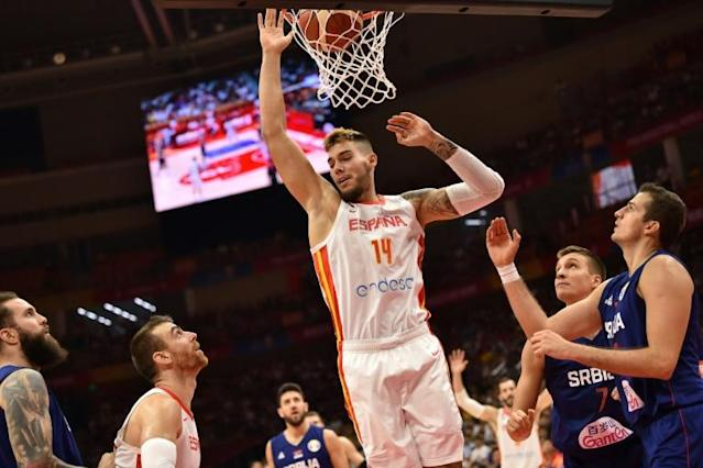 Willy Hernangomez and his brother, Juancho, are outshining Spain's famous Gasol siblings (AFP Photo/HECTOR RETAMAL )