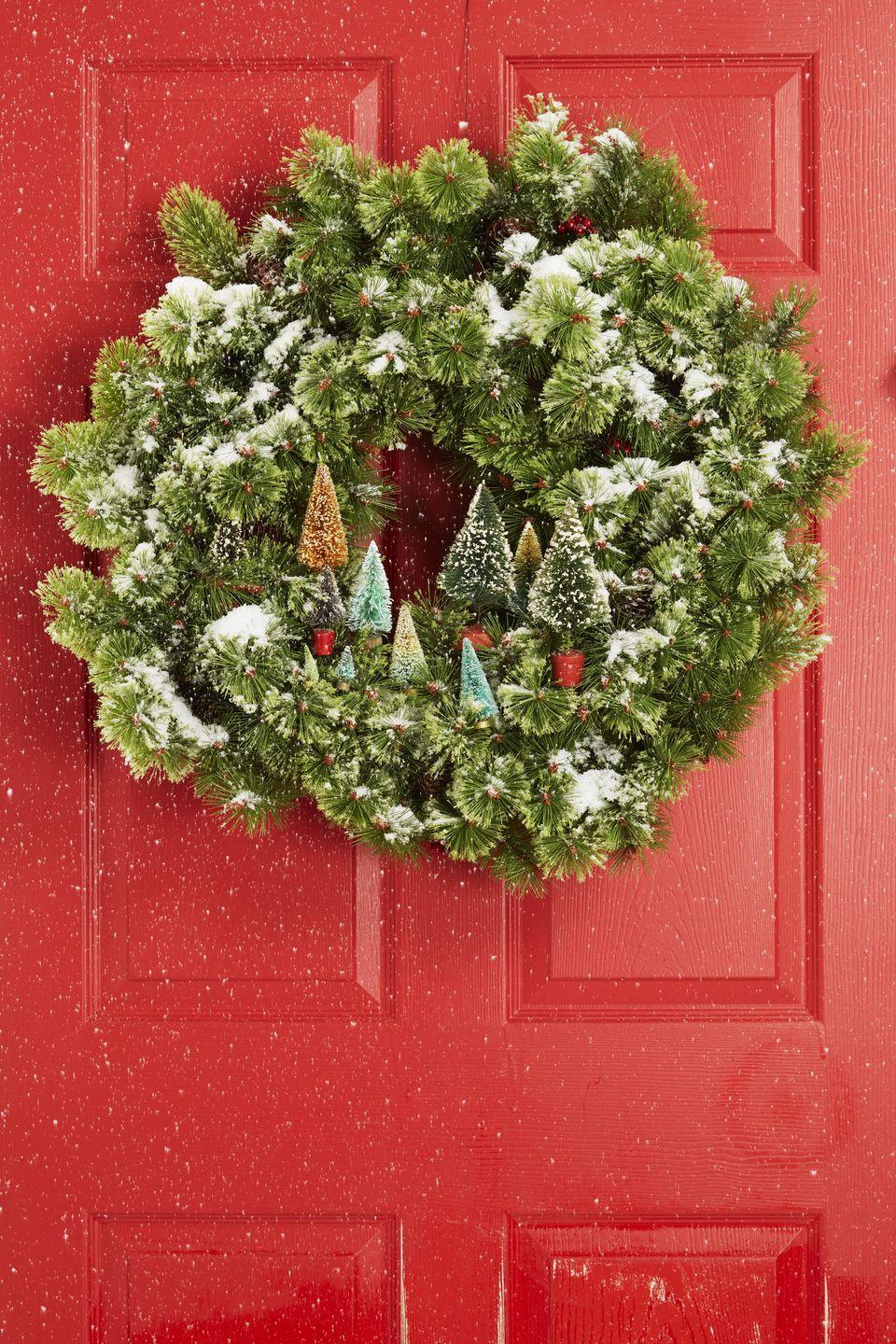 <p>A fresh dusting of (artificial) snow is just what a faux wreath needs. Attach tiny trees along the bottom and it'll become a petite magical forest. </p>