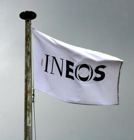 FILE PHOTO: An INEOS flag flies above an oil refinery building in Grangemouth, central Scotland April 28, 2008. REUTERS/David Moir/File Photo