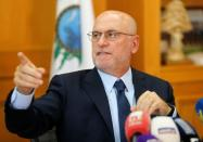 Youssef Finianos, then miniser of Public Works and Transportation gestures during a news conference in Beirut