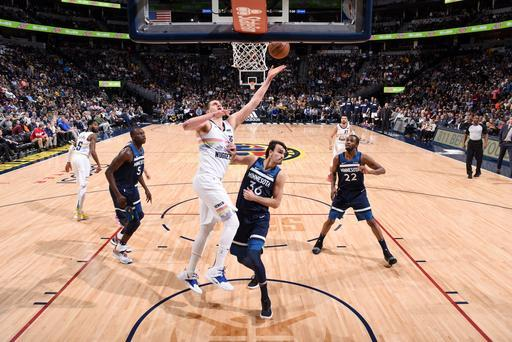 DENVER, CO - APRIL 10: Nikola Jokic #15 of the Denver Nuggets shoots the ball against the Minnesota Timberwolves on April 10, 2019 at the Pepsi Center in Denver, Colorado. (Photo by Garrett Ellwood/NBAE via Getty Images)