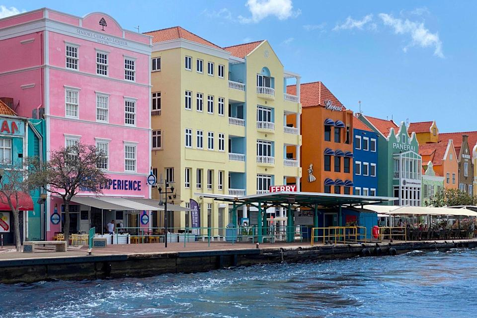 pastel colored colonial buildings on the waterfront of old town Willemstad, Curacao