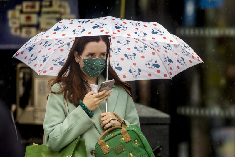 A woman walks through Belfast City CentreÕs shopping district wearing a face mask on the day it was announced face masks will become mandatory in shops in England. (Photo by Liam McBurney/PA Images via Getty Images)