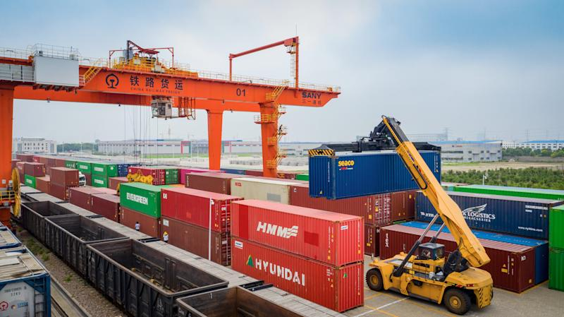 HAI'AN, CHINA - JULY 09: Aerial view of a crane hoisting shipping containers at a logistics base of China Railway Shanghai Group Co.,Ltd. on July 9, 2020 in Hai'an, Jiangsu Province of China. (Photo by Zhai Huiyong/VCG via Getty Images)