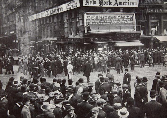 When a disaster report arrived in New York in April 1912, people gathered around a newspaper bulletin board.
