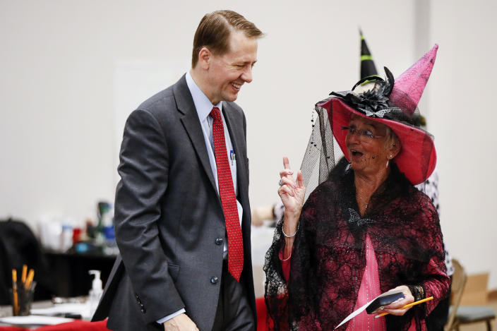 <p>Democratic gubernatorial candidate Richard Cordray, left, speaks with a polling worker before voting early on Halloween at the Franklin County Board of Election, Wednesday, Oct. 31, 2018, in Columbus, Ohio. (Photo: John Minchillo/AP) </p>