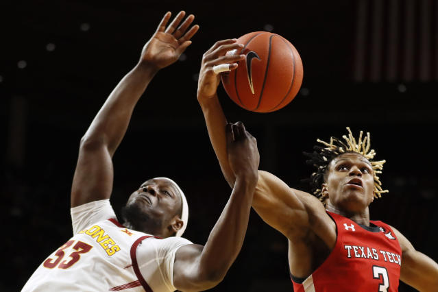 Texas Tech guard Jahmi'us Ramsey, right, grabs a rebound over Iowa State forward Solomon Young (33) during the first half of an NCAA college basketball game Saturday, Feb. 22, 2020, in Ames, Iowa. (AP Photo/Charlie Neibergall)