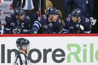 FILE - In this March 31, 2021, file photo, Winnipeg Jets' Blake Wheeler (26), Paul Stastny (25) and Pierre-Luc Dubois (13) talk between shifts during the first period of an NHL hockey game against the Toronto Maple Leafs in Winnipeg, Manitoba. Dubois is looking forward to finally getting to know his Jets teammates after spending much of last season in Winnipeg isolated from them due to COVID-19 protocols coupled with a rash of injuries. (John Woods/The Canadian Press via AP, File)