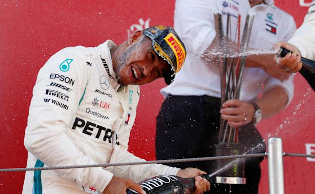 Formula One F1 - Spanish Grand Prix - Circuit de Barcelona-Catalunya, Barcelona, Spain - May 13, 2018 Mercedes' Lewis Hamilton sprays champagne as he celebrates on the podium after winning the race REUTERS/Juan Medina