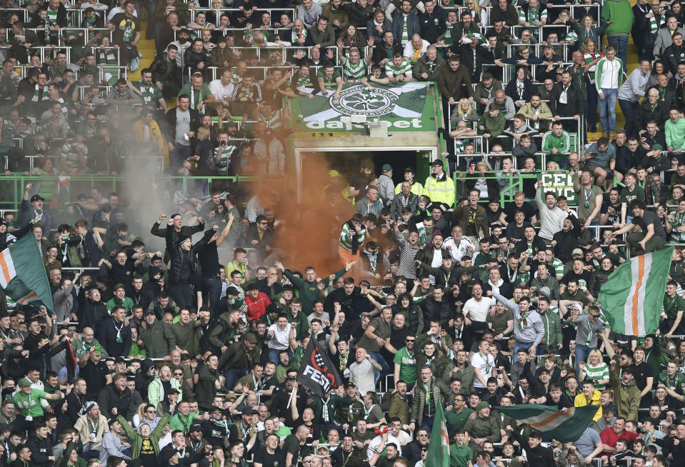 Celtic fans celebrate after the second Celtic goal, during the Scottish Premiership soccer match between Celtic and Rangers at Celtic Park, in Glasgow, Scotland, Sunday April 29, 2018. Celtic have won the Scottish Premiership league. (Jane Barlow/PA via AP)