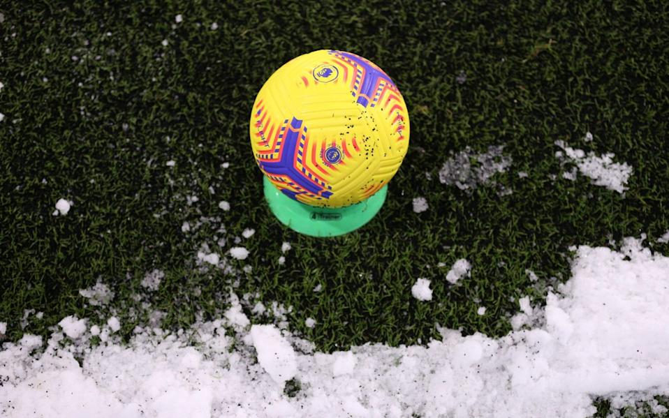 General view of the winter football with snow - Reuters