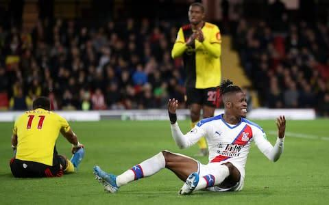 <span>Wilfried Zaha complains to the referee after being brought down</span> <span>Credit: getty images </span>