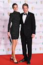 <p>As is Hugh Grant, with wife Anna Elisabet Eberstein sporting a high-neck LBD (little black dress).</p>