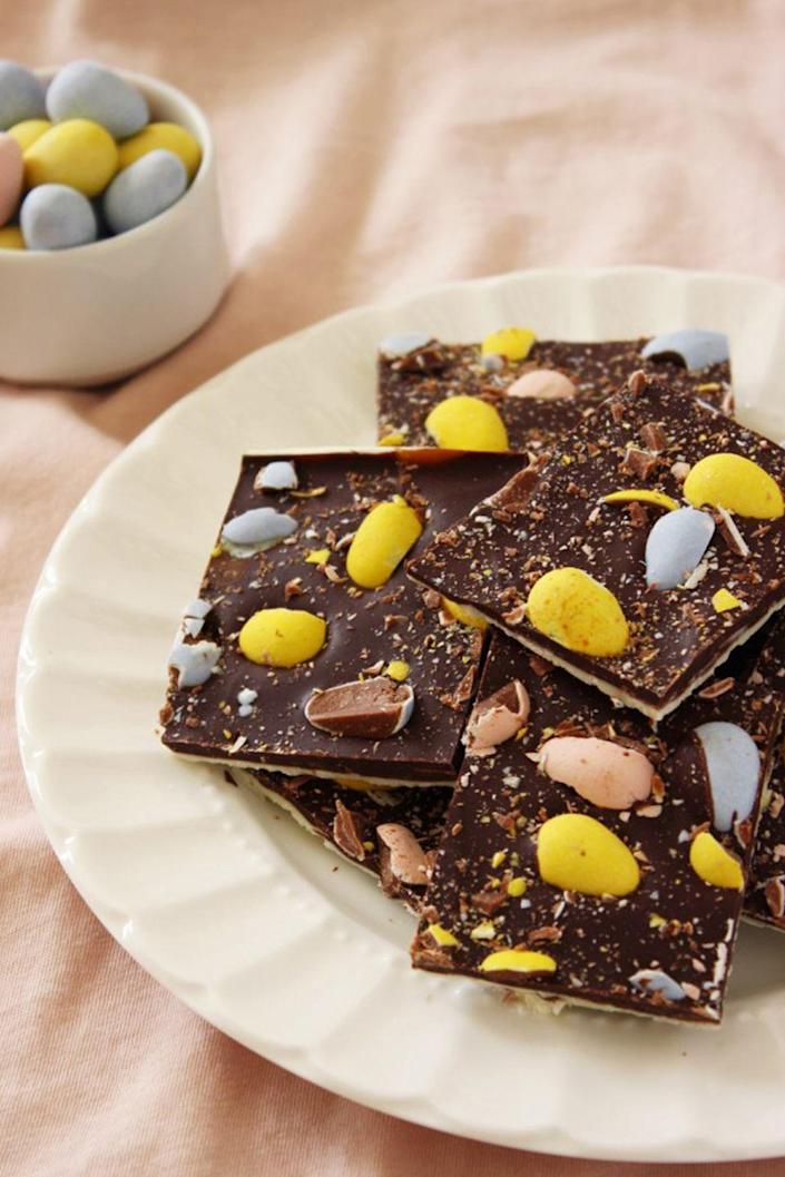 """<p>Chocolate buried in <em>more </em>chocolate — now that's an Easter dream come true. </p><p><a href=""""https://tutti-dolci.com/2012/04/cadbury-easter-egg-bark/"""" rel=""""nofollow noopener"""" target=""""_blank"""" data-ylk=""""slk:Get the recipe from Tutti Dolci »"""" class=""""link rapid-noclick-resp""""><em>Get the recipe from Tutti Dolci »</em></a></p>"""