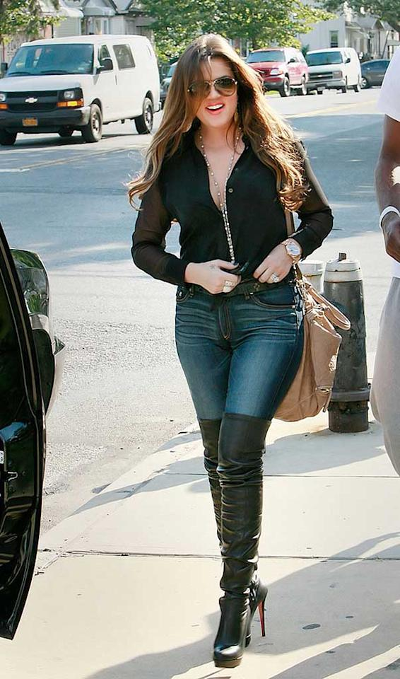 "Later, Khloe looked to be in better spirits, sporting thigh-high leather boots and a smile. The reality star was quite angry with some of her Twitter followers yesterday, who were annoyed with Khloe for taking a break from Twitter due to the fact that she was in New York attending a funeral for Lamar's cousin. ""Stop judging other people's lives that u know NOTHING about!"" she angrily tweeted. ""My husband&I r in NY 4a funeral 4 his fam. Senseless violence is disgusting!! A family member of his was killed and some of the comments you are saying due to the fact I am off twitter today are disgusting. Makes me think twice about social media."" Jackson Lee/<a href=""http://www.splashnewsonline.com/"" target=""new"">Splash News</a> - July 18, 2011"