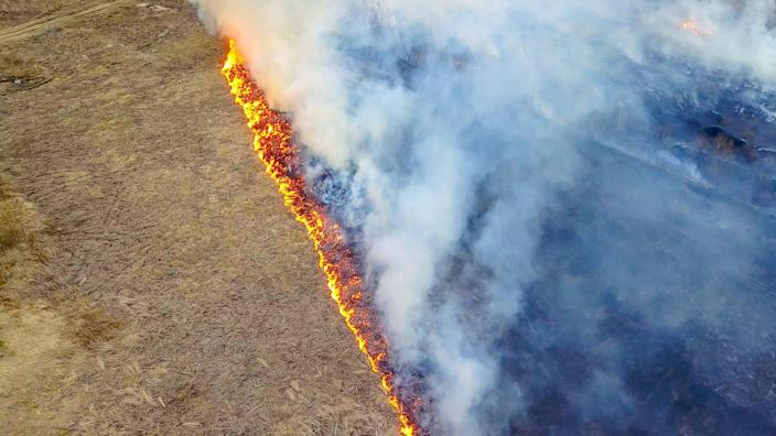 Aerial view of a wildfire ravaging drylands across the Western United States.