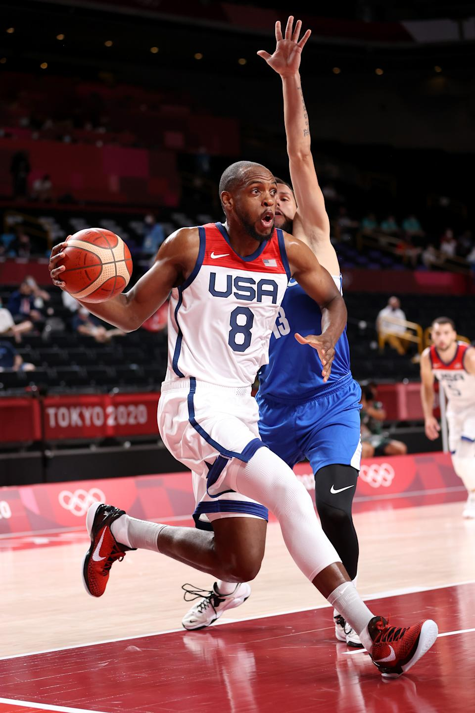 <p>SAITAMA, JAPAN - JULY 31: Khris Middleton #8 of Team United States drives to the basket Czech Republic during the first half of a Men's Basketball Preliminary Round Group A game on day eight of the Tokyo 2020 Olympic Games at Saitama Super Arena on July 31, 2021 in Saitama, Japan. (Photo by Gregory Shamus/Getty Images)</p>