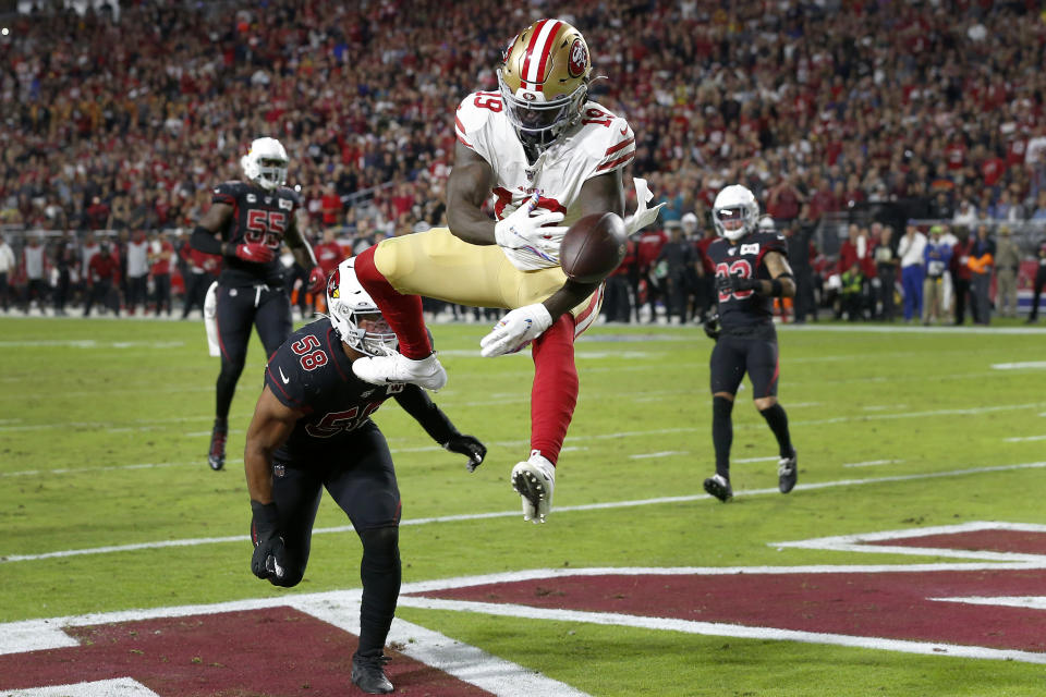 San Francisco 49ers wide receiver Deebo Samuel can't make the catch as Arizona Cardinals middle linebacker Jordan Hicks (58) defends during the first half of an NFL football game, Thursday, Oct. 31, 2019, in Glendale, Ariz. (AP Photo/Rick Scuteri)