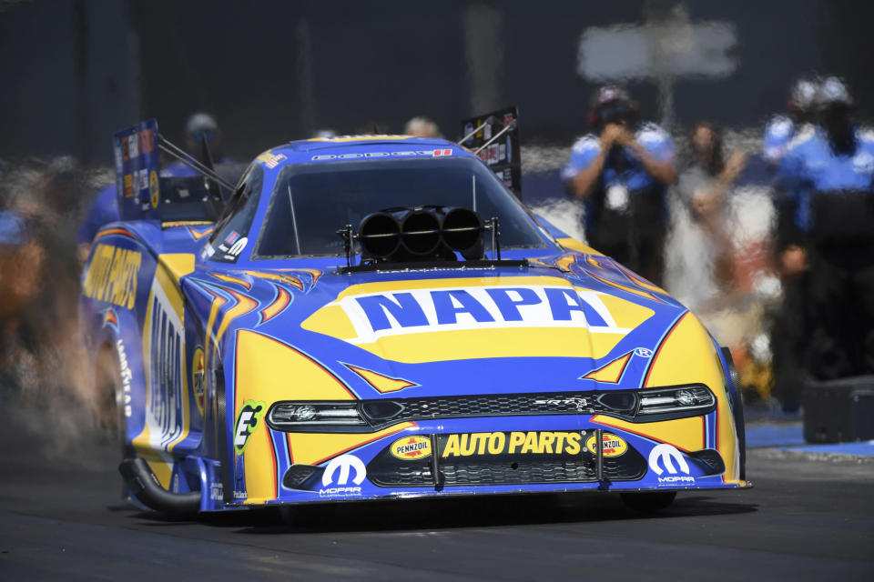 In this photo provided by the NHRA, Ron Capps wins at Auto Club Raceway at Pomona with his 4.151-second run at 297.75 mph over J.R. Todd in the Funny Car final at the 61st annual Lucas Oil NHRA Winternationals auto race, Sunday, Aug. 1, 2021, in Pomona, Calif. (Marc Gewertz/NHRA via AP)