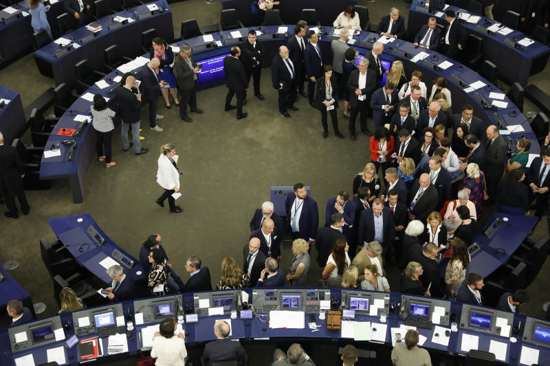 Members of the European Parliament queue to cast their ballots for the election of the German candidate Ursula von der Leyen as the new European Commission President at the European Parliament in Strasbourg, eastern France, Tuesday, July 16, 2019. (AP Photo/Jean-Francois Badias)