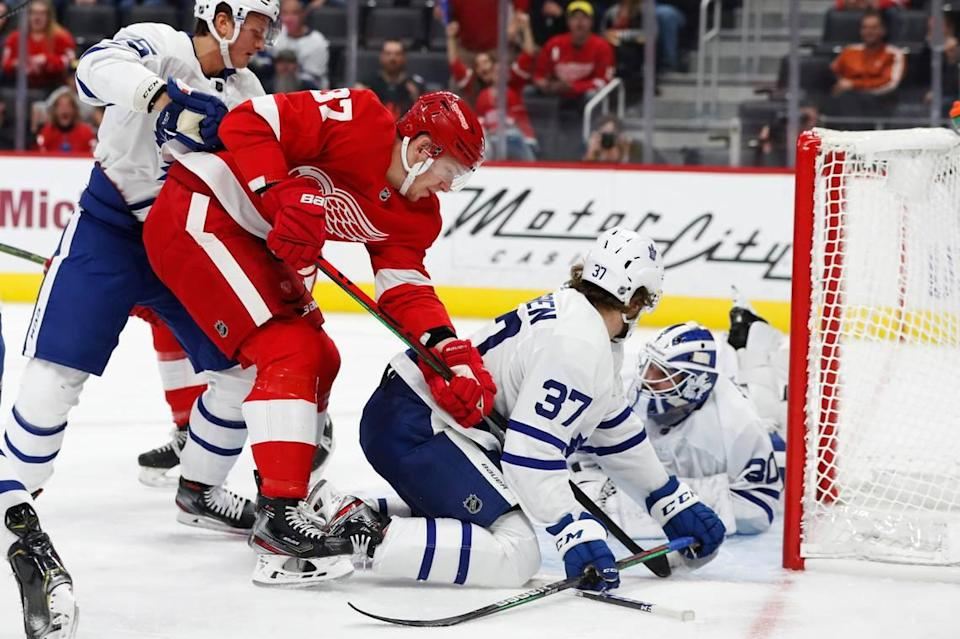 Detroit Red Wings right wing Evgeny Svechnikov (37) shoots the puck past Toronto Maple Leafs goaltender Michael Hutchinson (30) during the first period of an NHL hockey preseason game, Friday, Sept. 27, 2019, in Detroit. (AP Photo/Carlos Osorio)