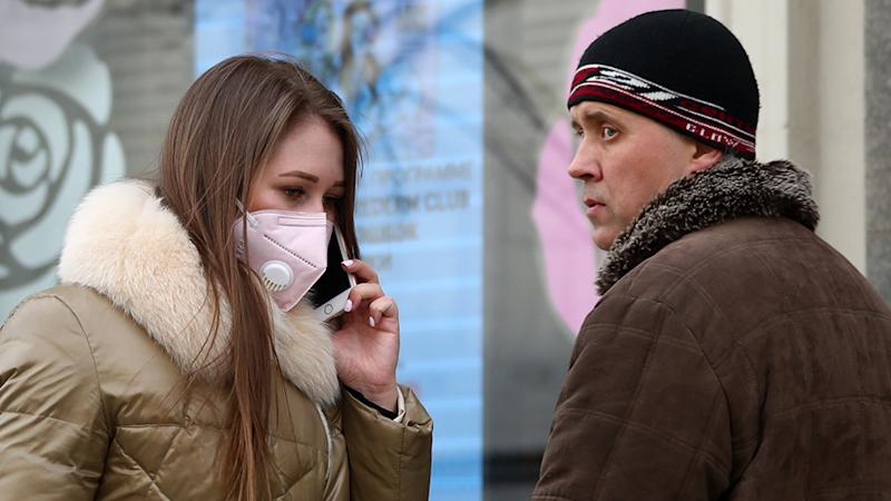 A young woman seen the day after a home isolation order was imposed by the Moscow authorities on citizens of all ages to contain the spread of the COVID-19 coronavirus infection.