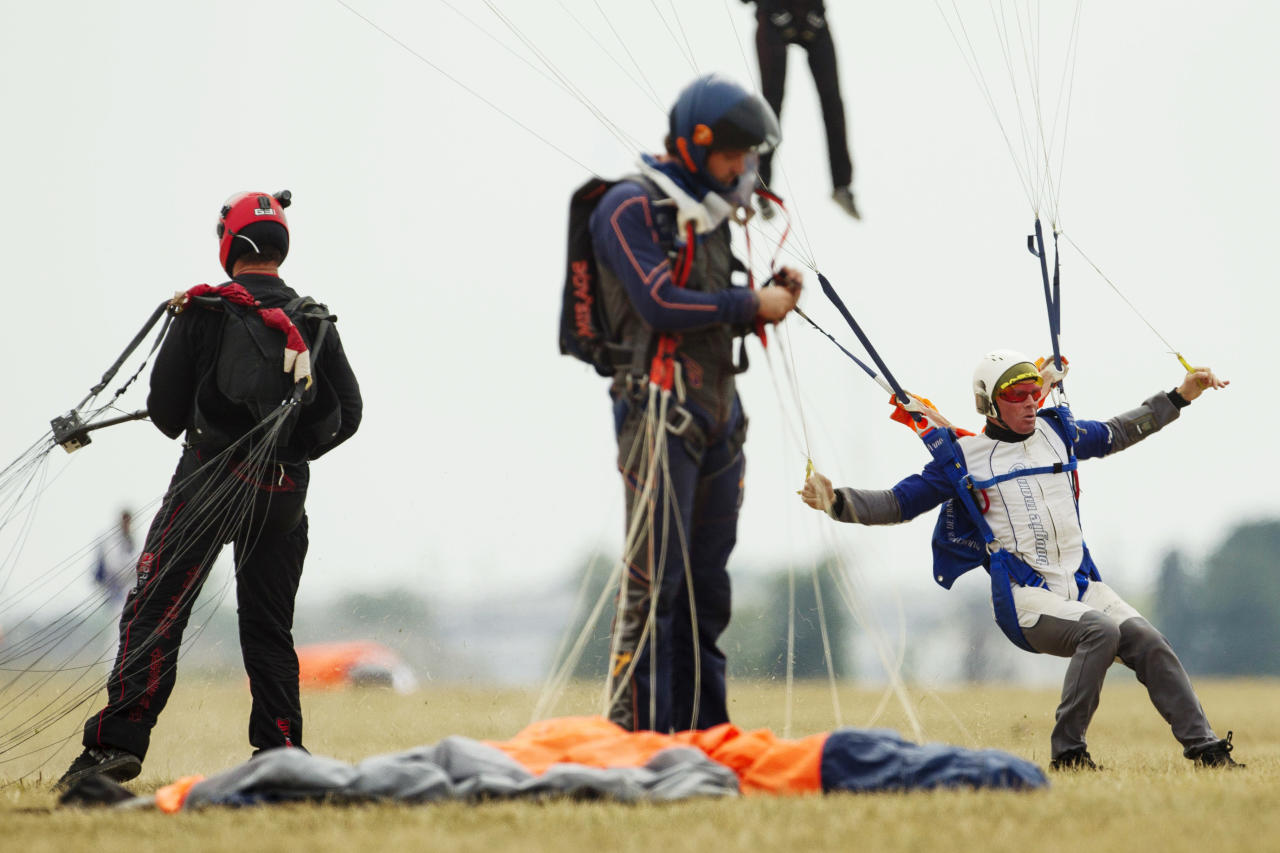 Skydivers land in a drop zone, Thursday, Aug. 2, 2012, in Ottawa, Ill. More than 140 skydivers reaching speeds in excess of 180 mph gathered in the skies over central Illinois to set a new world record in vertical flying. (AP Photo/Sitthixay Ditthavong)