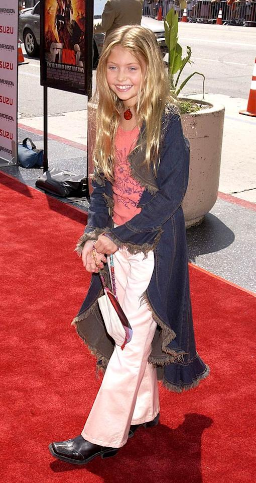 "July 2002: At the premiere of ""Spy Kids 2,"" Taylor was hippie chic in her long jean jacket, graphic tee, and flared khakis.   <a href=""http://www.seventeen.com/fashion/tips/worst-dressed-moments-2010?link=rel&dom=yah_omg&src=syn&con=art&mag=svn"" target=""new"">Worst Style Moments of 2010</a> Albert L. Ortega/<a href=""http://www.wireimage.com"" target=""new"">WireImage.com</a> - July 28, 2002"