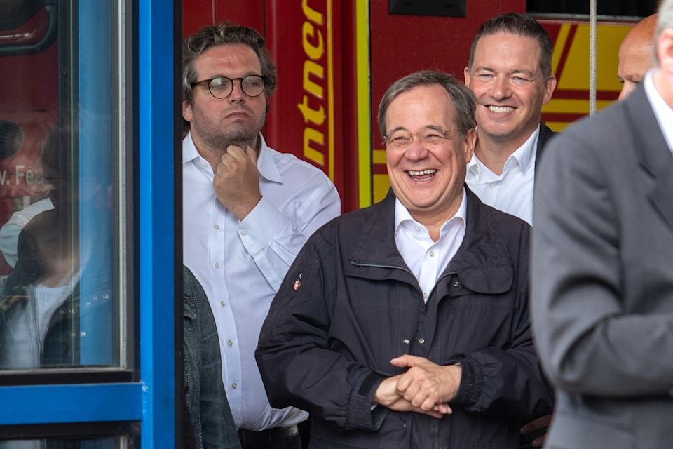 CDU leader and North Rhine-Westphalia's State Premier Armin Laschet laughs as the German president (unseen) delivers a speech during their visit to flood-hit Erftstadt, Germany July 17, 2021. Picture taken July 17, 2021 Marius Becker/Pool via REUTERS
