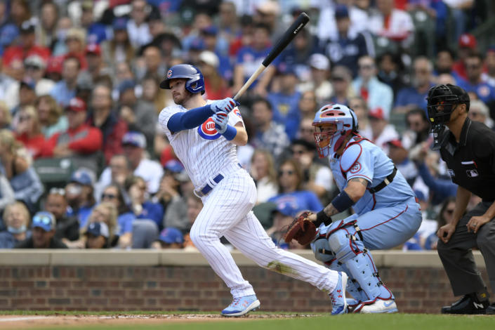 Chicago Cubs' Ian Happ watches his RBI single during the third inning of a baseball game against the St. Louis Cardinals Saturday, Sept. 25, 2021, in Chicago. (AP Photo/Paul Beaty)