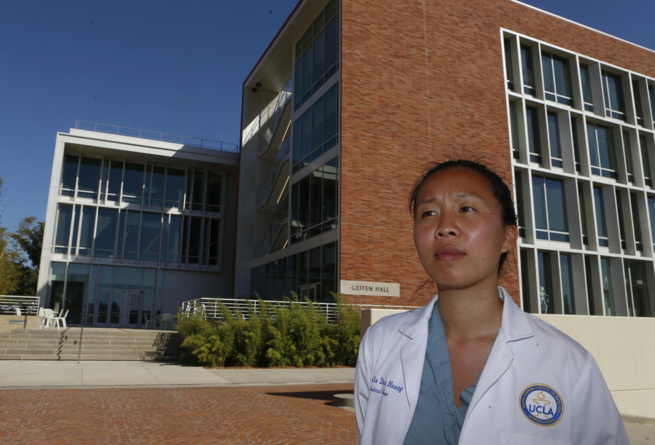 <p> In this Friday, Sept. 29, 2017, photo, Marcela Zhou, in her third year at the University of California at Los Angeles' medical school, poses for a photo at the David Geffen School of Medicine at UCLA, in Los Angeles. Zhou was born in Mexico after her family moved there from China. She wants to work in public health. (AP Photo/Damian Dovarganes) </p>