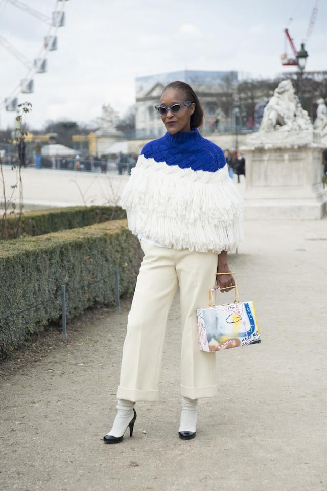 """<p>If you love <a rel=""""nofollow"""" href=""""http://www.glamour.com/gallery/stylish-outfits-to-wear-to-work-when-its-cold?mbid=synd_yahoostyle"""">winter whites</a>, try a pair of creamy cropped trousers with a chunky knit (even better when it's got a little pop of color), and complete the look with neutral booties. Just be sure to layer a thin knit or blouse underneath in case the heat gets really jacked up.</p>"""