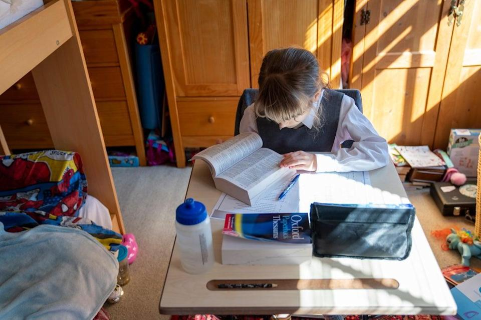 A child being home-schooled during lockdown (PA) (PA Archive)