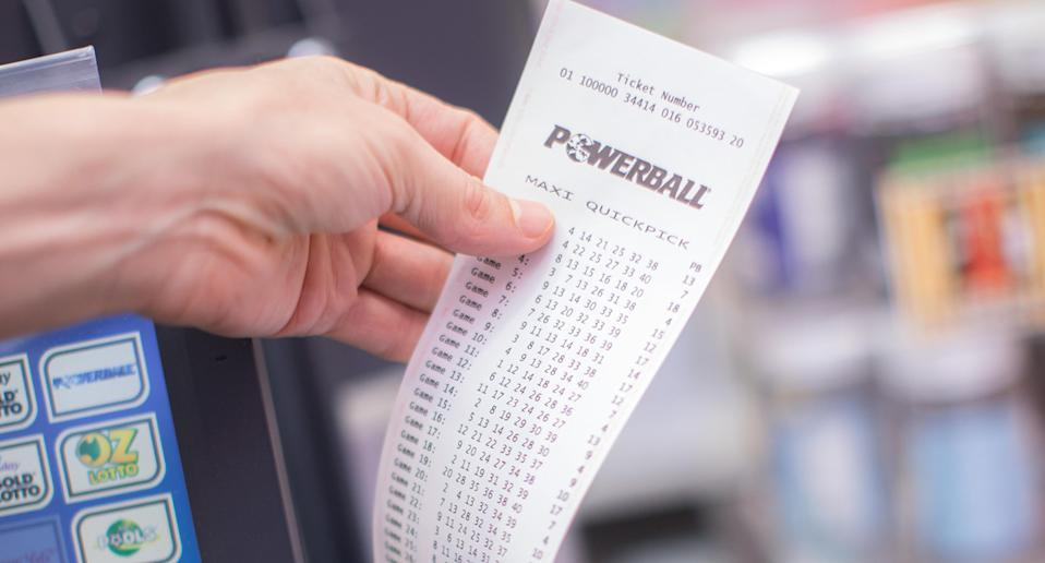 A Powerball ticket is printed out of a machine at a newsagency.