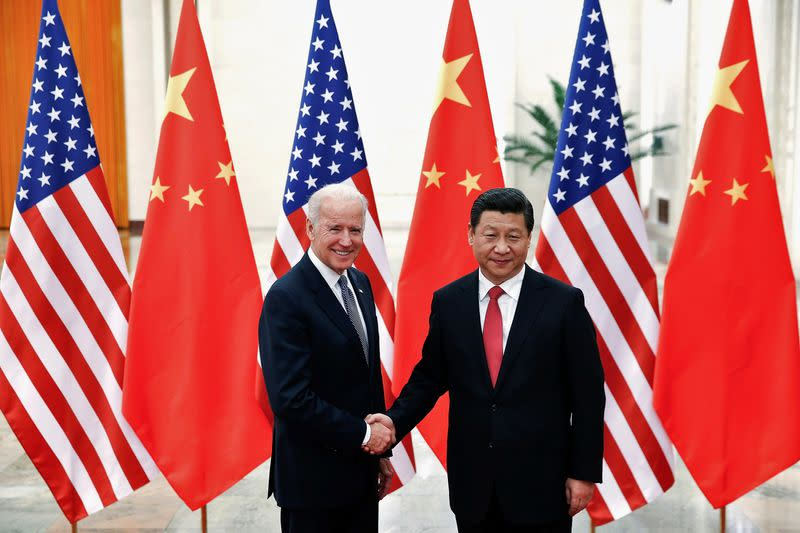 FILE PHOTO: Chinese President Xi Jinping shakes hands with U.S. Vice President Joe Biden inside the Great Hall of the People in Beijing