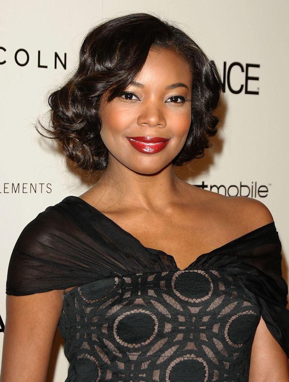 """<p>Go retro-cute like <strong>Gabrielle Union</strong> with loose pin curls that look gorgeous with an elegant dress and a long <a href=""""https://www.goodhousekeeping.com/beauty/makeup/g30625811/best-magnetic-eyelashes/"""" rel=""""nofollow noopener"""" target=""""_blank"""" data-ylk=""""slk:set of lashes"""" class=""""link rapid-noclick-resp"""">set of lashes</a>.</p>"""