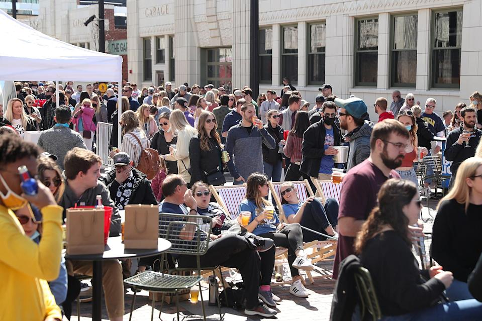 People gather for a watch party for the NCAA March Madness tournament Saturday, March 20, 2021, at the newly opened Bottleworks District of Indianapolis. The entertainment district is built up around the historic Coca Cola bottling plant, near the north end of Mass Ave.