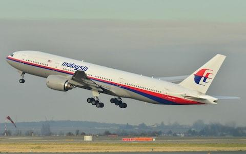 The Malaysia Airlines Boeing 777-200ER that disappeared from air traffic control screens on March 8, 2014, taking off from Roissy-Charles de Gaulle Airport in France. - Credit: Laurent Errera/AP