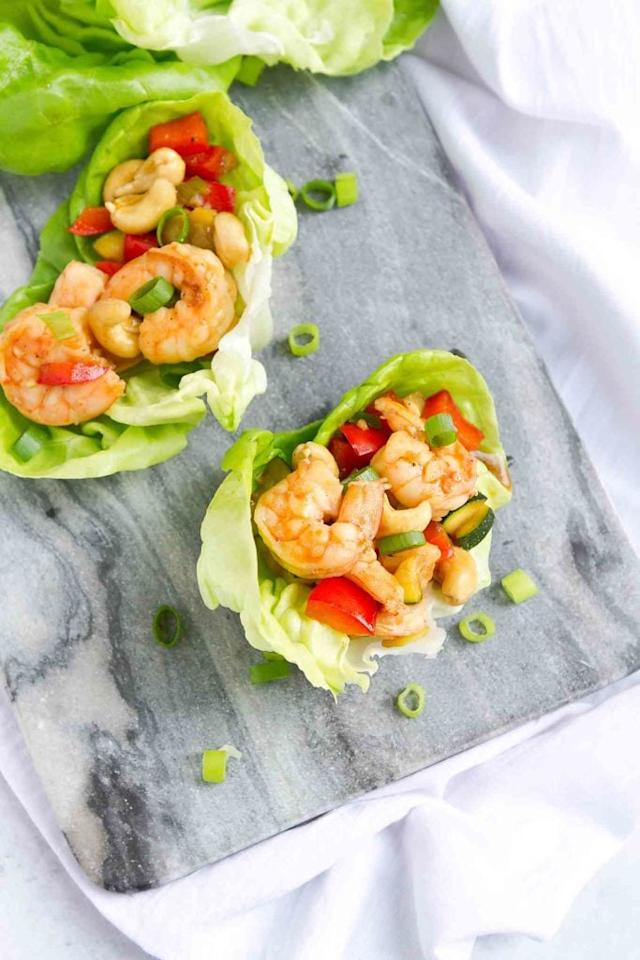 "<p>Shrimp cooks in a flash, and two of these tasty wraps clock in under 170 calories. You'll love the Asian-inspired sauce and crunchy cashews on top.</p> <p><strong>Get the recipe:</strong> <a href=""https://www.cookincanuck.com/cashew-shrimp-lettuce-wraps-recipe/"" target=""_blank"" class=""ga-track"" data-ga-category=""Related"" data-ga-label=""https://www.cookincanuck.com/cashew-shrimp-lettuce-wraps-recipe/"" data-ga-action=""In-Line Links"">cashew shrimp lettuce wraps</a></p>"