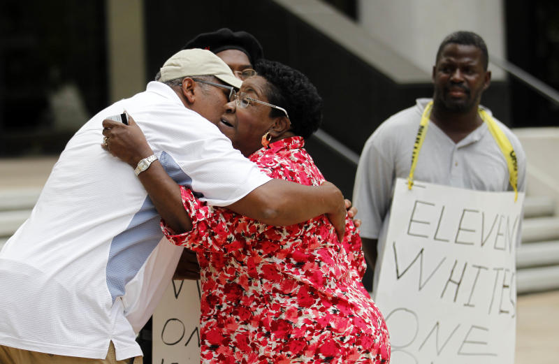 Rebecca Glover, aunt of a victim of a separate civil rights case against New Orleans police officers, hugs supporters of victims and their families outside Federal Court after five current or former police officers were convicted  in the deadly shootings on a New Orleans bridge after Hurricane Katrina, in New Orleans, Friday, Aug. 5, 2011.  Former officer Robert Faulcon, Sgts. Robert Gisevius and Kenneth Bowen, Officer Anthony Villavaso and retired Sgt. Arthur Kaufman were convicted of charges stemming from the cover-up of the shootings. All but Kaufman were convicted of civil rights violations stemming from the shootings. Kaufman, who investigated the shootings, was charged only in the cover-up. (AP Photo/Gerald Herbert)