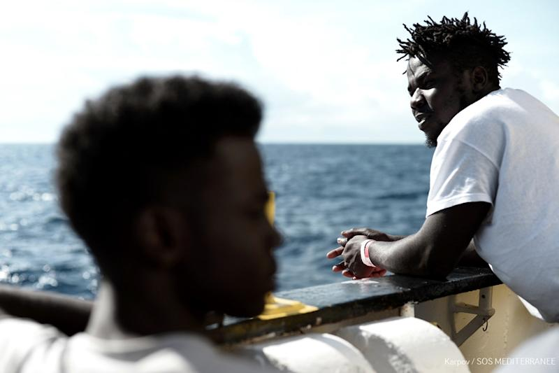 This handout picture obtained from French non-governmental organization Medecins Sans Frontieres -- Doctors Without Borders (MSF) -- shows migrants onboard the MV Aquarius at sea on June 14, 2018, after Italy refused to let it land (AFP Photo/-)