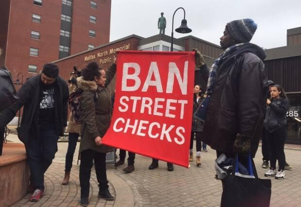 In March 2019, people marched through the streets of Halifax to call for an end to street checks. The province banned the practice in October that year. (Anjuli Patil/CBC - image credit)