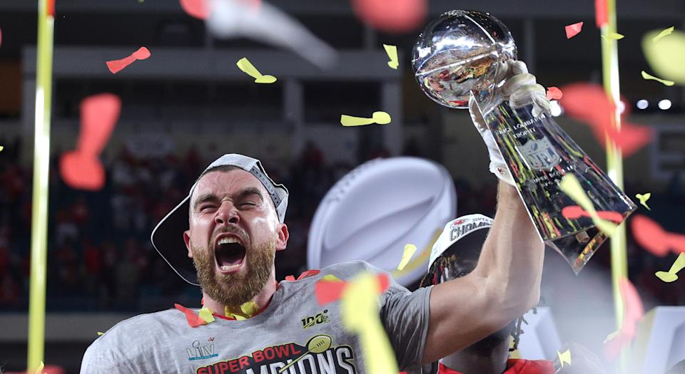 Travis Kelce of the Kansas City Chiefs raises the Vince Lombardi Trophy after defeating the San Francisco 49ers in Super Bowl LIV on Sunday. (Photo by Tom Pennington/Getty Images)