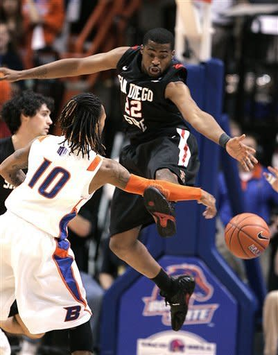 San Diego State's Chase Tapley (22) defends against the pass of Boise State's Tre' Nichols (10) during the first half of an NCAA college basketball game Wednesday, Feb. 29, 2012, in Boise, Idaho. (AP Photo/Matt Cilley)