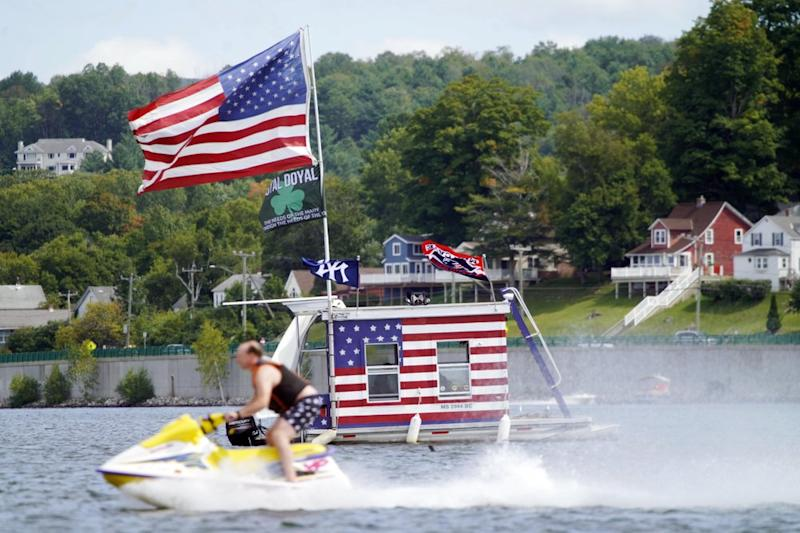 A jet skier passes a patriotic shanty-boat on Labor Day, Monday September 7. Source: AP
