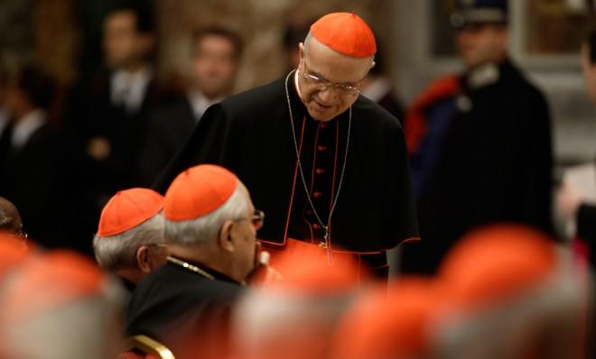 Vatican chamberlain Cardinal Tarcisio Bertone (standing) has the daunting job of keeping the conclave leak-proof.