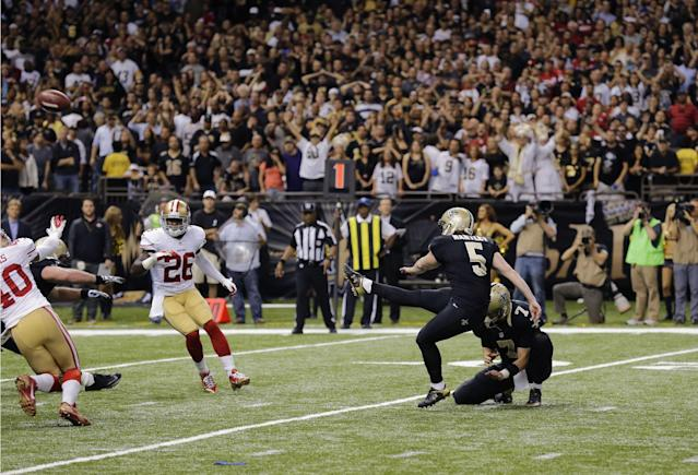 New Orleans Saints kicker Garrett Hartley (5) kicks the game winning field goal in the second half of an NFL football game against the San Francisco 49ers in New Orleans, Sunday, Nov. 17, 2013. The Saint won 23-20. (AP Photo/Bill Haber)