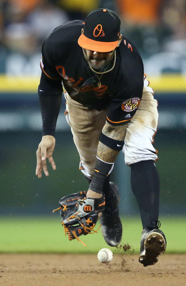 Baltimore Orioles shortstop Jonathan Villar misplays a grounder hit by Detroit Tigers' Willi Castro for a single during the fifth inning of a baseball game Friday, Sept. 13, 2019, in Detroit. (AP Photo/Duane Burleson)